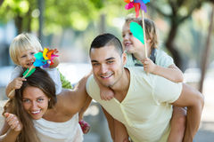 Family of four walking with children on vacation Stock Image