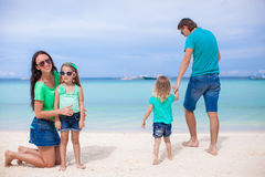 Family of four walking by the sea and enjoy beach Royalty Free Stock Image
