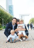 Family of four walking to city Stock Image