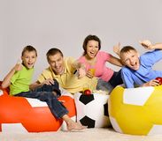 Family of four watching tv Stock Photo