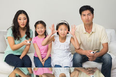 Family of four watching tv in the living room Royalty Free Stock Photography