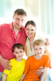 Family of four on a white Stock Photography