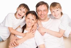 Family of a four on white Stock Photography