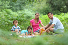 Family of fourv having a picnic Stock Photo