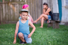 Family free time in a yard Stock Photography