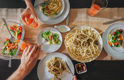 Family fresh dinner with grapefruit juice, pasta and salad Royalty Free Stock Image