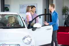 Family with friendly car dealer choosing car Royalty Free Stock Images
