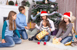 Family and friends celebrate Christmas Stock Photo