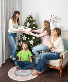 Family and friends celebrate Christmas. Royalty Free Stock Photos