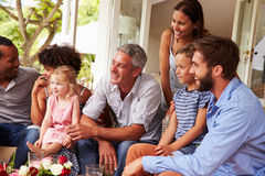 Family and friends gathered in a conservatory Stock Photography