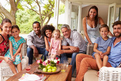 Family and friends posing for a picture in a conservatory Stock Image