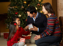 Family In Front Of Christmas Tree Stock Photo