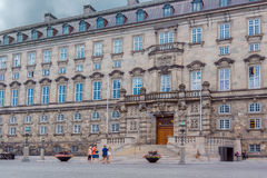 Family in front of danish parliament in Copenhagen. Tourists visiting the parliament in Copenhagen Stock Photos