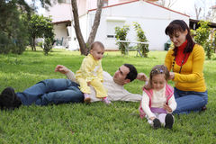 Family in front of the house. Family on a lawn in front of the house stock photography