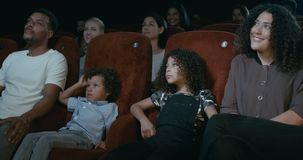 Family watching movie stock video footage