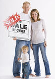 Family in Front of Sign Royalty Free Stock Photography