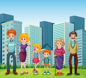 A family in front of the tall buildings in the city Royalty Free Stock Image