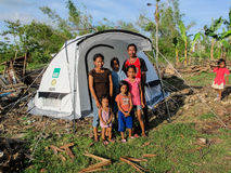 A family in front of their emergency shelter tent  after being made homeless by typhoon Haiyan, Stock Images