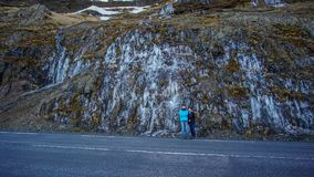 Family with frozen waterfall road trip scene in Iceland Royalty Free Stock Photos