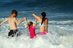 Family fun #2. Family playing in the waves Royalty Free Stock Photography