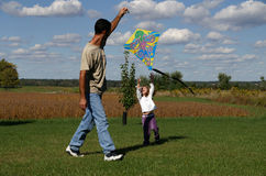 Family fun. A father and daughter playing outside with a kite royalty free stock photos