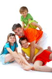 Family fun. A man has some fun, playing with his children/nephews/neice Stock Photography