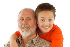 Family fun. Grandparent and his little gransdson posing for a fun family portrait Stock Photo