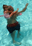Family Fun. Father and Daughter enjoy time together in the pool Royalty Free Stock Photography