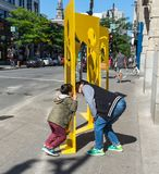 Family fun with art. For 375th Montreal anniversary, street art titled Km2 from various artists. One work at each kilometre square in Show Quarter Stock Photos