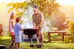 Family fun barbecue party royalty free stock photos