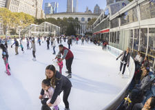 Family Fun at Bryant Park skating rink in New York City Stock Images