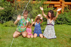 Family fun in the garden Stock Images