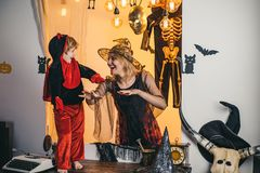 Family fun mother and child son having fun and celebrate Halloween in devil costume. Mom and little child boy on studio royalty free stock images