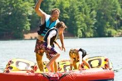Family Fun On The Lake/Tubing Stock Photography