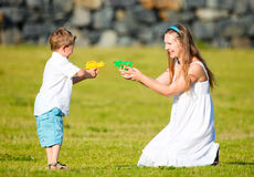 Family fun outdoors. Mother and son having fun outdoors at sunny summer day Royalty Free Stock Images