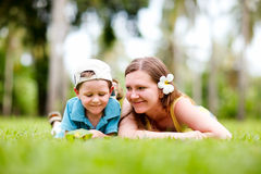 Family fun outdoors. Mother and son having fun outdoors at sunny summer day Stock Photos