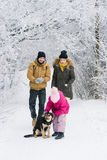 Family fun is photographed with a dog royalty free stock photo