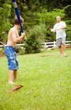 Family Fun/ Playing Ball. A father and son playing ball in the yard Stock Photos