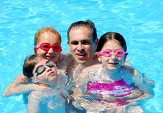 Family fun pool. Family having fun in swimming pool Royalty Free Stock Photo