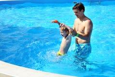 Family fun in pool. Father and son having fun in water pool Royalty Free Stock Image