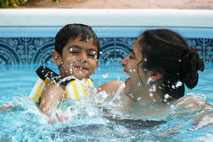 Family fun in the pool royalty free stock photos