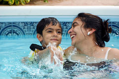 Family fun at the pool. Mother and son having a great time in the pool. Shallow DOF royalty free stock photography