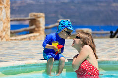 Family fun at the pool. Mother and son having fun at the pool Stock Photography