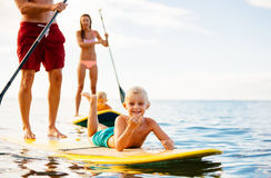 Family Fun, Stand Up Paddling. Family Having Fun Stand Up Paddling Together in the Ocean on Beautiful Sunny Morning Stock Image