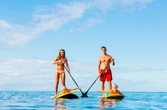 Family Fun, Stand Up Paddling. Family Having Fun Stand Up Paddling Together in the Ocean on Beautiful Sunny Morning royalty free stock images