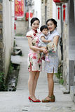 Family fun time, Chinese classic woman and baby in cheongsam Royalty Free Stock Images