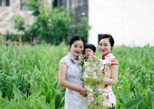Family fun time, Chinese classic woman and baby in cheongsam Stock Images