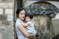Family fun time, Chinese woman and baby in cheongsam enjoy free time Royalty Free Stock Images