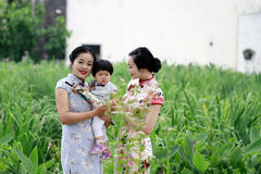 Family fun time, Chinese woman and baby in cheongsam enjoy free time Royalty Free Stock Photography