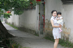 Family fun time, Chinese woman and baby in cheongsam enjoy free time Stock Photo